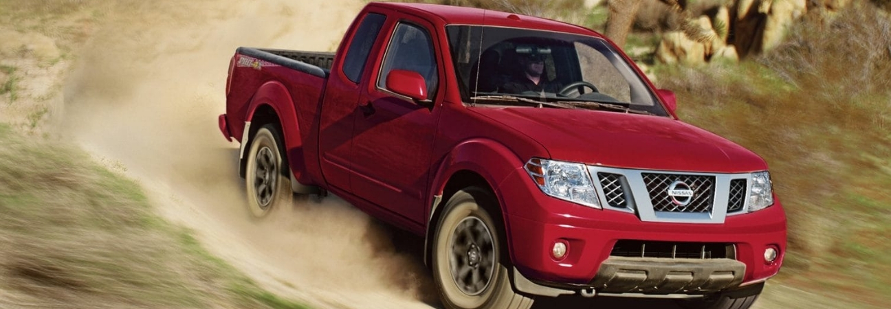 Red 2019 Nissan Frontier on dirt path